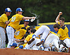 Lukas Morrill #30, of Kellenberg, second from left, squirts teammates with a bottle of water as the Firebirds celebrate their 1-0 win over St. John the Baptist in the Nassau-Suffolk CHSAA varsity baseball championship at Hofstra University on Monday, May 29, 2017.