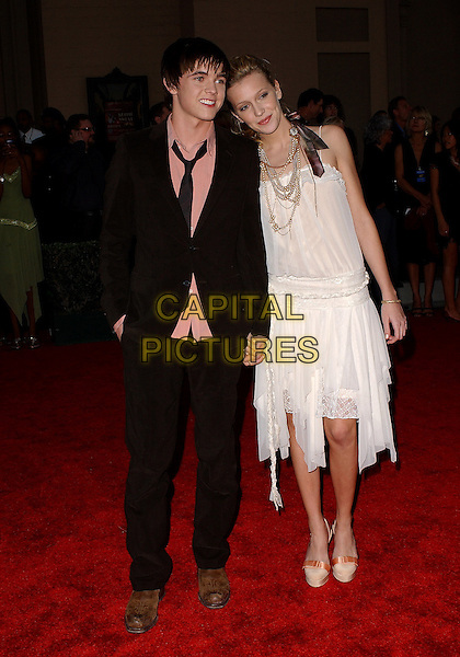 JESSE McCARTNEY & KATIE CASSIDY.The 33rd Annual American Music Awards held at The Shrine Auditorium in Los Angeles, California.  .November 22nd, 2005.Ref: DVS.AMA's full length black suit white dress.www.capitalpictures.com.sales@capitalpictures.com.Supplied By Capital PIctures