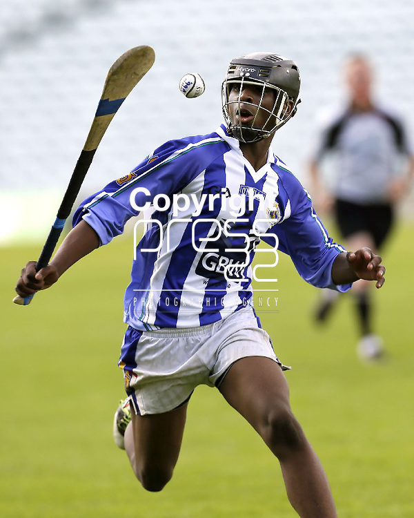 XX SPORT 07/07/2013 Christin Tshibangu of Ballyboden St Enda's keeps a close eye on the ball in the Feile Na nGael Division 1 final against Douglas at the Gaelic Grounds, Limerick. Picture: Don Moloney / Press 22