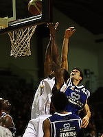 Saints forward Arthur Trousdell tries to block Heat import Mike Bell's shot during the National Basketball League match Wellington Saints and Harbour Heat at TSB Bank Arena, Wellington, New Zealand on Saturday 13 June 2009. Photo: Dave Lintott / lintottphoto.co.nz