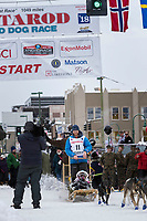 Wade Marrs and team leave the ceremonial start line with an Iditarider and handler at 4th Avenue and D street in downtown Anchorage, Alaska on Saturday March 3rd during the 2018 Iditarod race. Photo ©2018 by Brendan Smith/SchultzPhoto.com