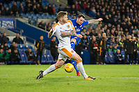 Lee Tomlin of Cardiff City shoots under pressure from Ondrej Mazuch of Hull City during the Sky Bet Championship match between Cardiff City and Hull City at the Cardiff City Stadium, Cardiff, Wales on 16 December 2017. Photo by Mark  Hawkins / PRiME Media Images.