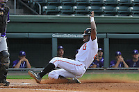 Center fielder Kyle Lewis (20) of the Mercer Bears slides home safely in a SoCon Tournament game against the Furman Paladins on Thursday, May 26, 2016, at Fluor Field at the West End in Greenville, South Carolina. Mercer won, 6-1. Lewis is considered a 2016 Top 5 draft pick. (Tom Priddy/Four Seam Images)