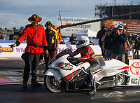 Oct 29, 2016; Las Vegas, NV, USA; NHRA pro stock motorcycle rider Kristen Ashby with crew member during qualifying for the Toyota Nationals at The Strip at Las Vegas Motor Speedway. Mandatory Credit: Mark J. Rebilas-USA TODAY Sports