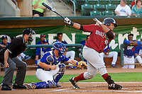 Alexis Rivera (40) of the Idaho Falls Chukars at bat against the Ogden Raptors with home plate umpire Patrick Sharshel and Raptors catcher Kyle Farmer (18) behind the plate at Lindquist Field on September 5, 2013 in Ogden Utah.  (Stephen Smith/Four Seam Images)