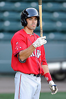 Infielder/third baseman Carlos Asuaje (20) of the Greenville Drive waits his turn for batting practice on the team's Media Day first workout on Tuesday, April 1, 2014, at Fluor Field at the West End in Greenville, South Carolina. (Tom Priddy/Four Seam Images)