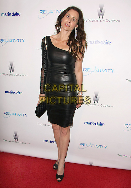 MINNIE DRIVER .Relativity Weinstein Company 68th Annual Golden Globe Awards After Party Presented by Marie Claire held at the Beverly Hilton, Beverly Hills, California, USA..January 16th, 2011.full length black leather dress one shoulder sheer clutch bag .CAP/ADM/TB.©Tommaso Boddi/AdMedia/Capital Pictures.