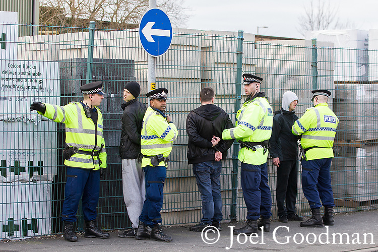 © Joel Goodman - 07973 332324 . 25/02/2012 . Hyde , UK . Police detain several men at the demonstration . The EDL demonstrate following an assault on Daniel Stringer-Prince, whose family say they do not want the demonstration to take place in the town in their son's name. The EDL say Daniel was assaulted by a gang of Asian men . At the same time , the BNP hold a rally in the town . Photo credit : Joel Goodman