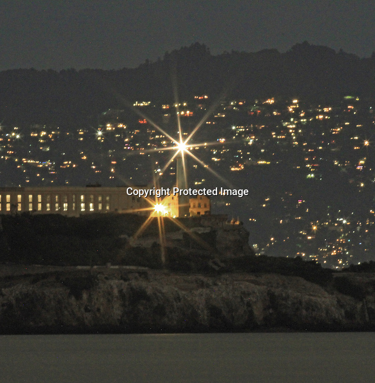 Alcatraz Island lighthouse at night from Fort Point, SF, CA