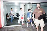 John Fawcett, the CEO and co-founder of Quantopian, (in light blue shirt) leaves after a meeting on future business strategy with his executive team in the offices of Quantopian in the Downtown Crossing area of Boston, Mass., on Wed., June 1, 2016. A couple of participants took part in the meeting remotely via a webcam on one of the laptops in the center of the room. Quantopian is a Boston-based start-up that provides a platform for building, testing, and executing stock trading algorithms.