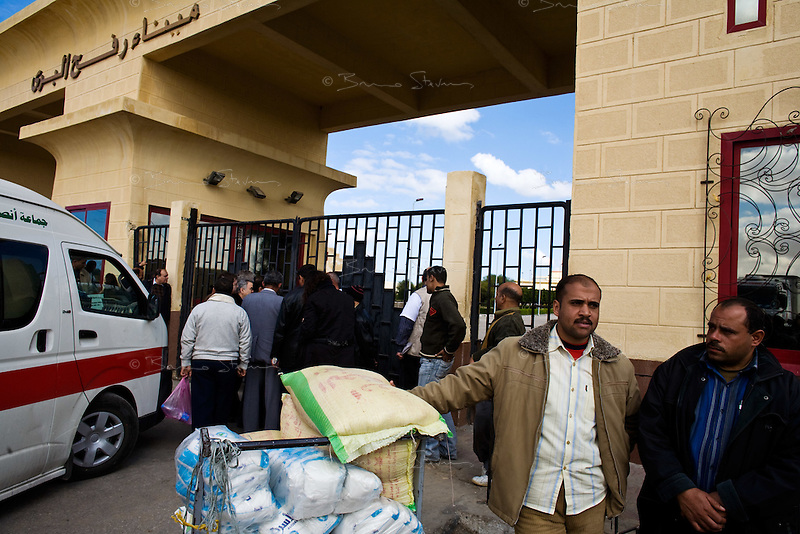Rafah, Egypt, Jan 09, 2009.In observance with Egyptian-Israeli security agreements, the Rafah border crossing remains closed except for humanitarian goods, no one is allowed to cross. Private and NGO's humanitarian aid arrive to the crossing amid general confusion and disorganization. On the 13th day of the Israeli operation in Gaza, one and a half million people are still deprived of electricity and basic supplies, as well as being unable to flee from the densely populated combat zone.
