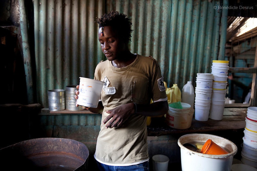A Kenyan man drinks Busaa, a traditional fermented beer, at the Madiaba Busaa Club at midday in a Nairobi slum on March 27, 2013. Busaa is made by crudely fermenting maize, millet, sorghum or molasses. At Kshs 35 per liter it is much cheaper than a Kshs120 half-liter bottle of commercial beer. The local brew was legalised in 2010 and since then busaa clubs have become increasingly popular. Drinking is on the rise in Kenya, especially among young people. Photo: Benedicte Desrus