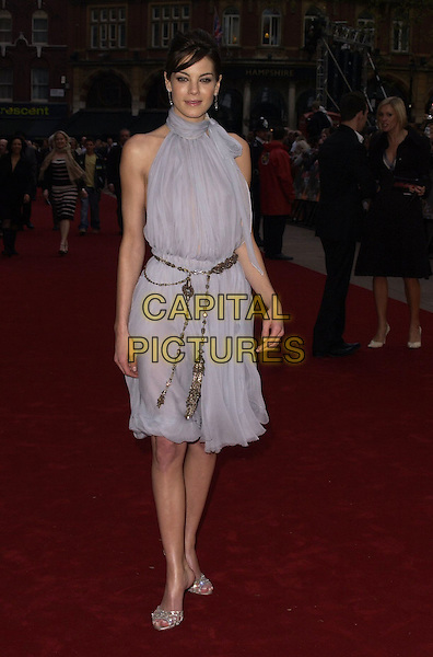 """MICHELLE MONAGHAN.""""Mission Impossible 3"""" UK Film Premiere - Arrivals, Odeon Leicester Square, London, UK. .April 25th 2006.Ref: CAN.full length grey blue dress belt hand on hip.www.capitalpictures.com.sales@capitalpictures.com.©Capital Pictures"""