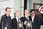 LOS ANGELES - FEB 6: Billy Bob Thornton; Gerry Beckley; Dewey Bunnell; John Stamos at a ceremony where their rock band 'America' in honored with a star on the Hollywood Walk of Fame in Los Angeles, California