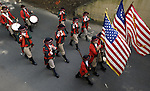 Marching Fife and Drum Corps march to the Windsor town green, during the 27th annual Windsor Fife and Drum Corps Muster, groups from Connecticut, New York, New Jersey, Rhode Island, were among the groups participating this year, the muster was held on the green in front of Windsor Town Hall. (Jim Michaud/Journal Inquirer) .