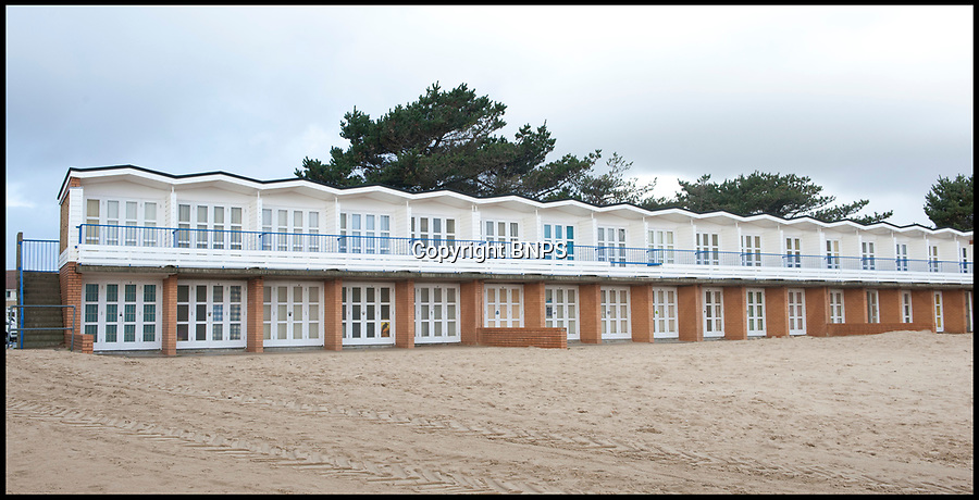 BNPS.co.uk (01202)558833<br /> Pic: BNPS<br /> <br /> The regular beach huts at nearby Sandbanks beach.<br /> <br /> Plans have been unveiled for 28 eco-friendly beach huts to be built into a fragile seaside cliff to protect it from erosion.<br /> <br /> The timber-clad 'pods' will be erected on two tiers hallway up the 80ft sloping seaside cliff near to Sandbanks in Poole, Dorset.<br /> <br /> The stilts will act as pile foundations and be drilled into the ground to improve the stability of the cliff.<br /> <br /> Each beach hut will have its own balcony overlooking the sea and 140sq ft of floor space.<br /> Plans have been submitted to the local council to approve.