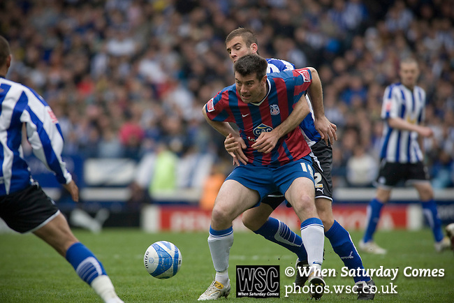 Crystal Palace's Alan Lee holds off a Sheffield Wednesday marker at Hillsborough during the crucial last-day relegation match. The match ended in a 2-2 draw which meant Wednesday were relegated to League 1. Crystal Palace remained in the Championship despite having been deducted 10 points for entering administration during the season.