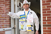 "Carlos Arredondo, 57, stands in his front door in Roslindale, Boston, Massachusetts, USA, on Sat., March 31, 2018. Arredondo is well known as the ""man in the cowboy hat"" who helped out in the aftermath of the Boston Marathon Bombing in 2013. Carlos is wearing a jacket that he has used to create a t-shirt design for when he runs the Boston Marathon later this year. Though he has run the race unofficially previously, this will be the first time he runs it ""legally,"" he says."