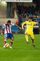 Atletico de Madrid´s Arda Turan and Villarreal´s Manuel Trigueros during 2014-15 La Liga match between Atletico de Madrid and Villarreal at Vicente Calderon stadium in Madrid, Spain. December 14, 2014. (ALTERPHOTOS/Luis Fernandez) /NortePhoto