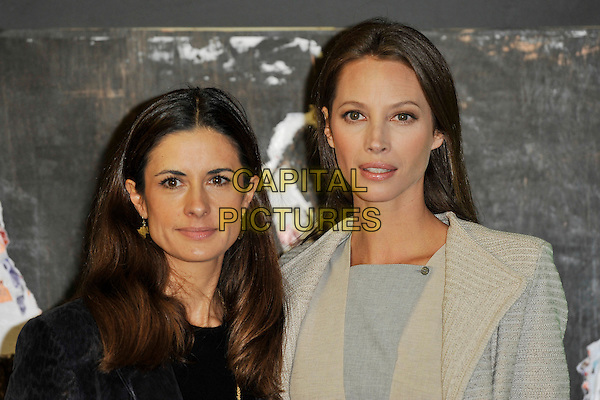 "LIVIA GIUGGIOLI & CHRISTY TURLINGTON BURNS .At the ""No Woman No Cry"" premiere during the 54th BFI London Film Festival, BFI Southbank, London, England, UK, October 23rd 2010..portrait headshot  jacket cream blue grey gray pinstripe beige  black .CAP/MAR.© Martin Harris/Capital Pictures."