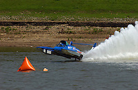"""Frame 1: Greg Hopp in the U-100 """"Leland Unlimited"""" gets airborne entering turn 1 during qualifying, does a """"blowover"""", lands rights side up down but backwards, digs in and flips upside down. The safety crew rescues Hopp through the trapdoor in the bottom. The boat suffered damage to the left sponson, Hopp had no injuries but was done for the weekend."""