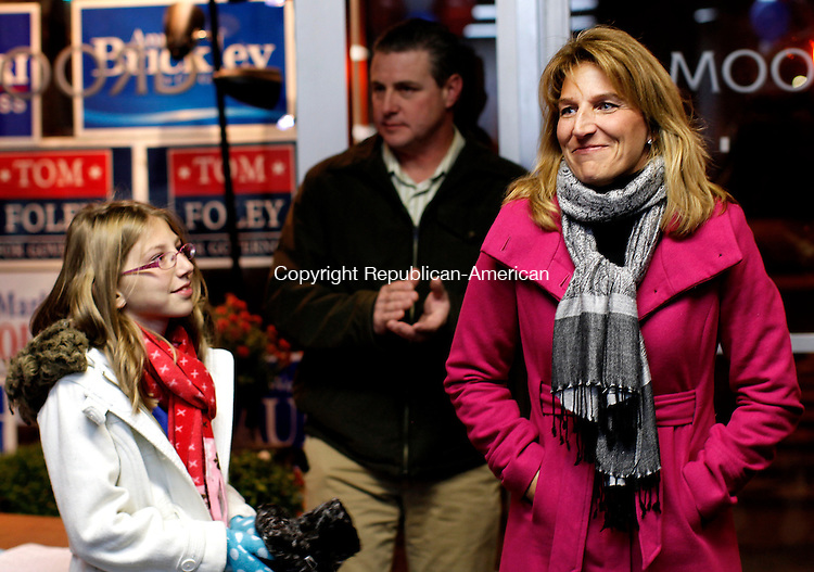 Torrington, CT- 02, November 2010-110210CM06 Wendy Traub enters the Torrington Republican headquarters Tuesday night after being defeated by Democratic opponent, Michelle Cook for the 65th district house seat. Supporting Traub are her daughter, Julia, 12 (left) and husband, Ken (background).   Christopher Massa Republican-American