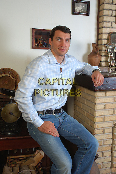 Wladimir Klitschko.Photosession..July 10th, 2007.half length jeans denim blue white check shirt  3/4 sitting .CAP/PER/IP.©IP/PersonaStars/CapitalPictures