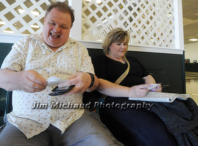 (Boston Ma 060615) Jason Fischer, 44,  and his sister, Rebecca, 42, both of Malden, looking over their tickets for the big race, including American Pharoah, prior to the Belmont Stakes, Saturday, June 6, 2015, at Suffolk Downs in Boston. Herald Photo by Jim Michaud