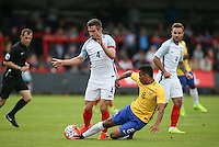 Allan of Brazil tackles Lewis Cook (AFC Bournemouth) of England during the International match between England U20 and Brazil U20 at the Aggborough Stadium, Kidderminster, England on 4 September 2016. Photo by Andy Rowland / PRiME Media Images.