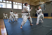 The MSU Taido Karate Club hosted a workshop over the weekend with black belts from the U.S. Taido Association, as well as members of Georgia Tech's student club. Pictured training at MSU's Joe Frank Sanderson Center are Georgia Tech student Brianna Tomlinson (left) and MSU senior Brenna Carlisle, an animal and dairy science major from Sugar Land, Texas. Approximately six MSU students will compete in the U.S. Taido Tournament on March 11 in Atlanta.<br />   (photo by Megan Bean / &copy; Mississippi State University)