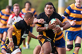 Toto Tongamoa looks for support from Tell Kuka as he tries to bust the tackle of Viliami Fihaki. Counties Manukau Premier Club Rugby game between Patumahoe  and Bombay played at Patumahoe on Saturday 24th April 2010..Patumahoe won 52 - 5 after leading 26 - 0 at halftime.