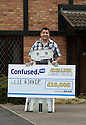 01/08/14 <br /> <br /> ***FREE PHOTO FOR EDITORIAL USE***<br /> <br /> Confused.com £10,000 Mega Draw winner, Lee Binnie, with cheque and Brian the Robot at his home in Burton Upon Trent, Staffordshire.<br /> <br /> All Rights Reserved: F Stop Press Ltd. +44(0)1335 300098   www.fstoppress.com.