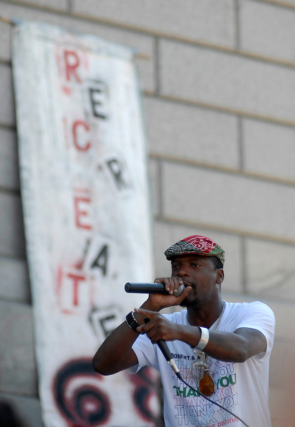 24 Aug 08: M-1 of the hip hop duo Dead Prez perfors on the steps of the Colorado state capitol building. On the day before the Democratic National Convention is scheduled to begin about 1,500 people participated in the ReCreate 68 rally, which included a march from the Colorado state capitol building to the Pepsi Center.