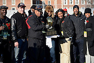 November 28, 2013  (Washington, DC) H.D. Woodson head coach Steven Scott poses with the championship trophy with city officials after winning the 2013 DCIAA varsity football championship game November 28, 2013.  (Photo by Don Baxter/Media Images International)