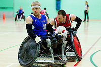 15 AUG 2011 - LEEDS, GBR - Canada's Fabien Lavoie (right) attempts to manoeuvre behind Great Britain's Aaron Phipps during the wheelchair rugby exhibition match between the two teams .(PHOTO (C) NIGEL FARROW)