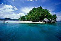 Locals at a white sand beach on a lush tropical island, Mindanao, Philippines