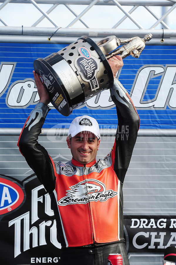 Nov. 13, 2011; Pomona, CA, USA; NHRA pro stock motorcycle rider Eddie Krawiec celebrates after clinching the world championship at the Auto Club Finals at Auto Club Raceway at Pomona. Mandatory Credit: Mark J. Rebilas-.