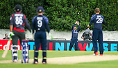 ICC World T20 Qualifier - GROUP B MATCH - SCOTLAND V UAE at Grange CC, Edinburgh - players wait for outcome as Scotland fielder Calum MacLeod takes a catch in the deep to dimiss UAE bat Umair Ali — credit @ICC/Donald MacLeod - 09.07.15 - 07702 319 738 -clanmacleod@btinternet.com - www.donald-macleod.com