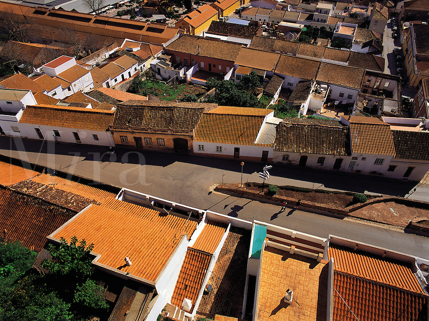 Looking down on the brightly-coloured tiled roofs of the town of Silves, Algarve, Portuga
