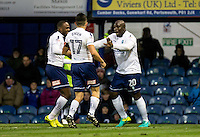 Adebayo Akinfenwa of Wycombe Wanderers scores the winning goal and celebrates during the FA Cup 1st round match between Portsmouth and Wycombe Wanderers at Fratton Park, Portsmouth, England on the 5th November 2016. Photo by Liam McAvoy.