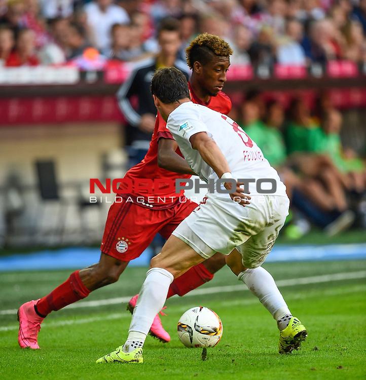 12.09.2015, Allianz Arena, M&uuml;nchen, GER, 1. FBL, FC Bayern M&uuml;nchen vs. FC Augsburg<br /> Kingsley Roman (M&uuml;nchen), Markus Feulner (Augsburg)<br /> <br /> <br /> Foto &copy; nordphoto /  Bratic