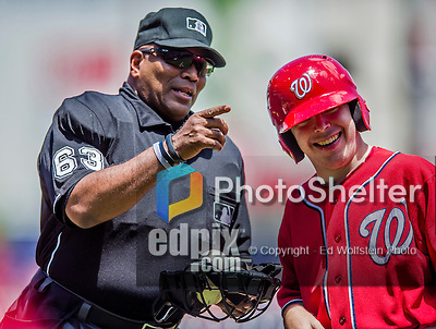 31 May 2014: MLB Umpire Laz Diaz gets replenished with baseballs from the Washington Nationals Bat Boy during a game against the Texas Rangers at Nationals Park in Washington, DC. The Nationals defeated the Rangers 10-2, notching a second win of their 3-game inter-league series. Mandatory Credit: Ed Wolfstein Photo *** RAW (NEF) Image File Available ***