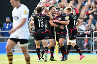 Jamie George of Saracens celebrates his first try with team-mates. Aviva Premiership match, between Saracens and Wasps on October 8, 2017 at Allianz Park in London, England. Photo by: Patrick Khachfe / JMP