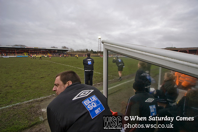 Workington AFC 0 Boston United 1, 24/02/2008. Borough Park, Blue Square North. A man with a sponsor's jacket watching the Blue Square North fixture between hosts Workington AFC (red) and Boston United at Borough Park. The visitors won with a solitary sixth-minute goal by Jon Rowan in front of 388 spectators. Both Workington AFC and Boston United were members of the Football League, the Cumbrians losing League status in 1977 while the Lincolnshire club were relegated in 2007 and demoted two divisions for financial irregularities. Photo by Colin McPherson.