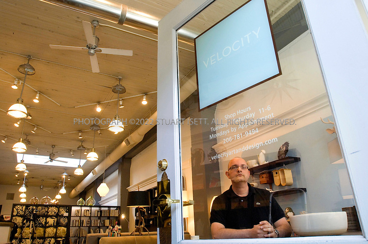 5/4/2007--Seattle, WA, USA..John Tusher, owner of Velocity, a modern design store in Seattle's Belltown district...Photograph ©2007 Stuart Isett.All rights reserved