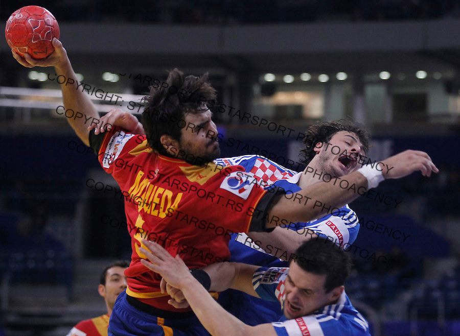 BELGRADE, SERBIA - JANUARY 29:Jorge Maqueda (L) of Spain vies with Ivan Nincevic of Croatia during the Men's European Handball Championship 2012 Bronze medal match between Croatia and Spain at Arena Hall on January 29, 2012 in Belgrade, Serbia. (Photo by Srdjan Stevanovic/Starsportphoto.com ©)