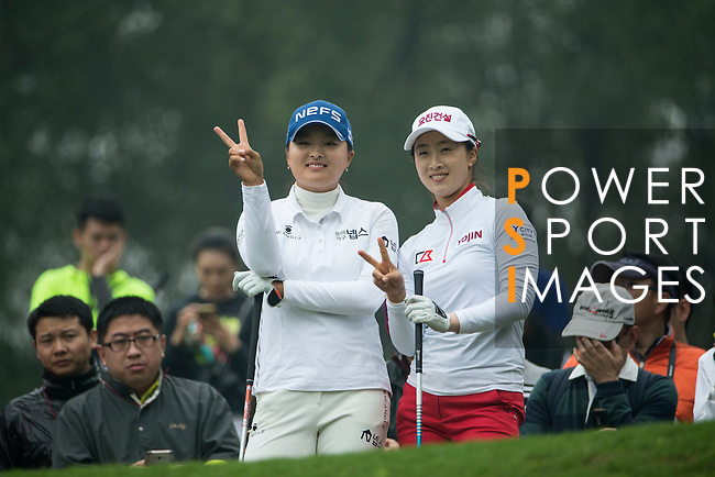 Jin Young Ko of South Korea (left) and Bo Kyung Kim of South Korea (right) chat during Round 4 of the World Ladies Championship 2016 on 13 March 2016 at Mission Hills Olazabal Golf Course in Dongguan, China. Photo by Victor Fraile / Power Sport Images