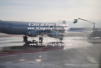 When there are freezing conditions and precipitation, deicing an aircraft is crucial. Frozen contaminants cause critical control surfaces to be rough and uneven disrupting smooth air flow and greatly degrading the ability of the wing to generate lift (force) and increasing drag. This situation can cause a crash. If large pieces of ice separate when the aircraft is in motion, they can be ingested in engines or hit propellers and cause catastrophic failure. Frozen contaminants can jam control surfaces, preventing them from moving properly. Because of this potentially severe consequence, de-icing is performed at airports where temperatures are likely to drop below the freezing point.<br /> <br /> De-icing techniques are also employed to ensure that engine inlets and various sensors on the outside of the aircraft are clear of ice or snow.<br /> <br /> De-icing on the ground is usually done by spraying aircraft with a deicing fluid such as Propylene glycol, similar to ethylene glycol antifreeze used in some automobile engine coolants. Ethylene Glycol (EG) is still in use for aircraft deicing in some parts of the world because it has a lower operational use temperature (LOUT) than PG and is more versatile in application, but Propylene Glycol (PG) is more common because it is classified as non-toxic, unlike Ethylene Glycol. Nevertheless, it still must be used with a containment system to capture the used liquid, so that it cannot seep into the ground and streams. Even though classified as non-toxic, it has negative effects in nature, as it uses oxygen during breakdown, causing life to suffocate. (In one case, a significant snow in Atlanta in early January 2002 caused an overflow of such a system, briefly contaminating the Flint River downstream of the Atlanta airport.) Many airports recycle used deicing fluid, separating water and solid contaminants, enabling reuse of the fluid in other applications.  Wikipedia