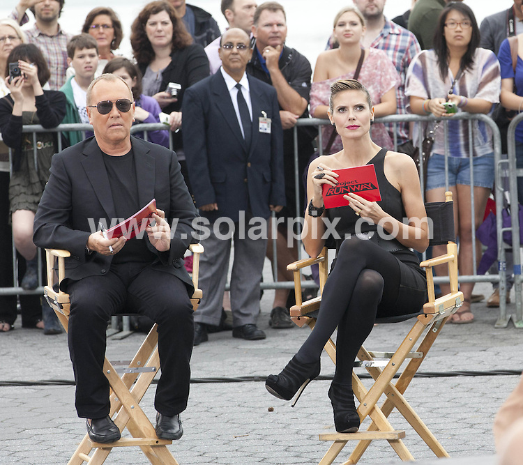 "**ALL ROUND PICTURES FROM SOLARPIX.COM**                                             **SYNDICATION RIGHTS FOR UK, AUSTRALIA, DENMARK, PORTUGAL, S. AFRICA, SPAIN & DUBAI (U.A.E) & ASIA (EXCLUDING JAPAN) ONLY**                                                                                  Caption:  Kim Kardashian, Nina Garcia, Michael Kors, Heidi Klum - ""Project Runway"" Filming at Battery Park in New York City on June 24, 2011 - Battery Park - New York City, NY, USA                                                                             This pic:  Heidi Klum & Michael Kors                                                                                            JOB REF: 13614       PHZ       DATE: 24.06.2011                                                           **MUST CREDIT SOLARPIX.COM OR DOUBLE FEE WILL BE CHARGED**                                                                      **MUST AGREE FEE BEFORE ONLINE USAGE**                               **CALL US ON: +34 952 811 768 or LOW RATE FROM UK 0844 617 7637**"