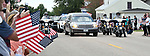 The procession pauses briefly at Waterloo City hall where hundreds of residents had gathered to pay respects to fallen ISP Trooper Nick Hopkins. Dozens of police departments joined in the procession from St. Louis to Waterloo for slain Illinois State Police Trooper Nick Hopkins on Monday August 26, 2019. <br /> Photo by Tim Vizer